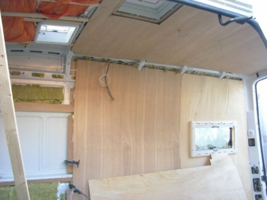 View in the side door showing the roof vents in and the side window in and part of the wall paneling fitted