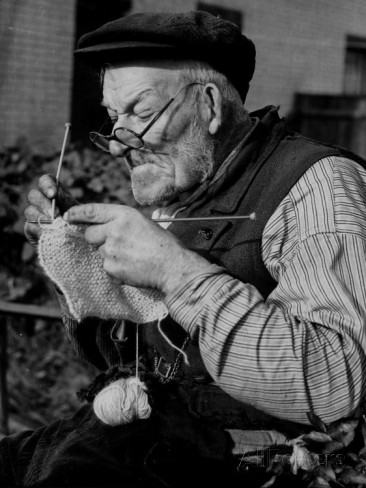 Elderly Man Knitting Garments During Drive to Provide Goods to Servicemen During the War