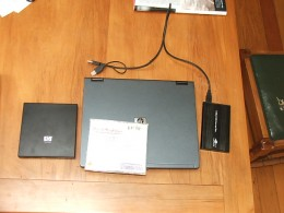 "14"" HP NC4200 laptop, external DVD and external hard drive. CD case for scale."