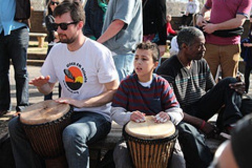 A man and a boy playing Drums