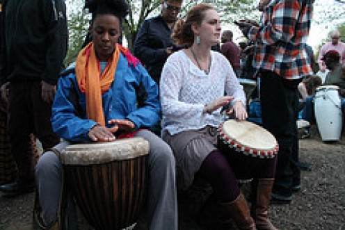 Two women playing Drums