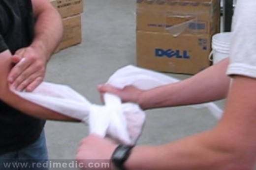 Triangular bandage used on a wrist injury