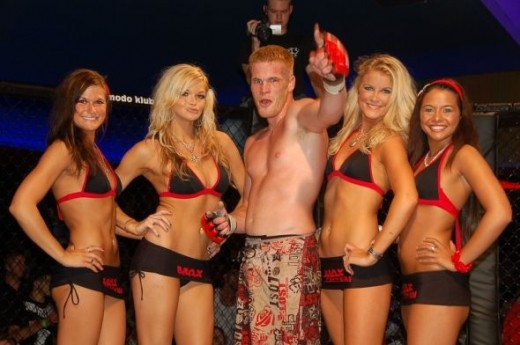 MMA Fighter Teddy 'Red' Worthington shows off his Combat Gloves with the sexy MMA Ring Girls after a victory at a recent Max Fights event.