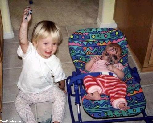 That little girl looks so proud of her artwork!