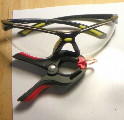 Washer holder and safety glasses