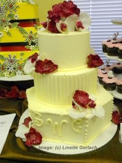 yellow and red wedding cake