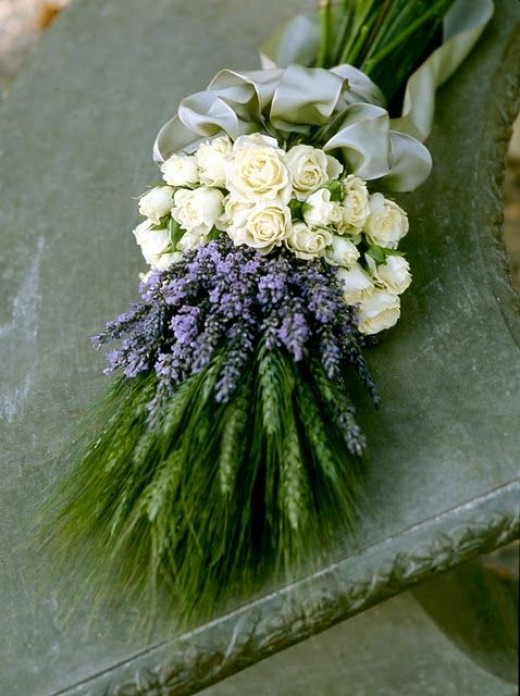 A wand style bouquet made from the ultimate purple flower - lavender, teamed with white roses.
