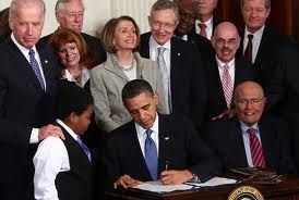 President Obama, signing the PPACA