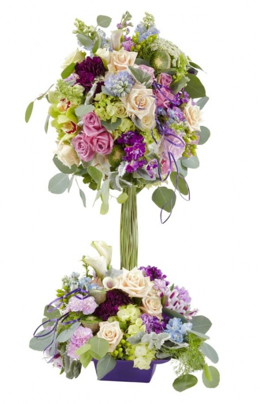 Two tier centerpiece from Smither oasis. Does this satisfy everyone? I love the look of this, but with so many flowers, I don't think it would be an economy option.