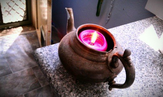 Teapot candle that is always alight at anniversaries and family celebrations in memory of our grandmothers.