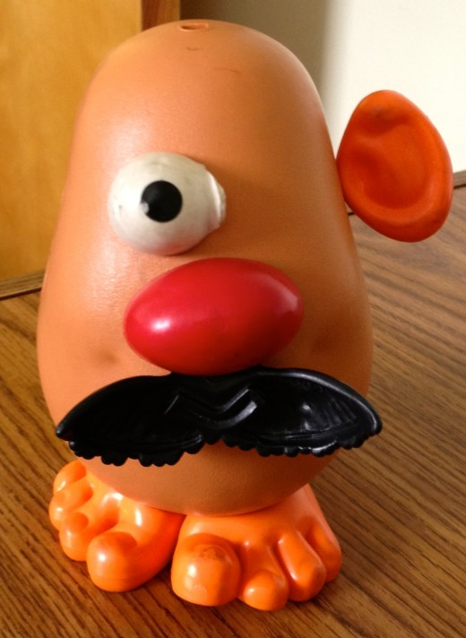 A distorted Mr. Potato Head missing some body parts.