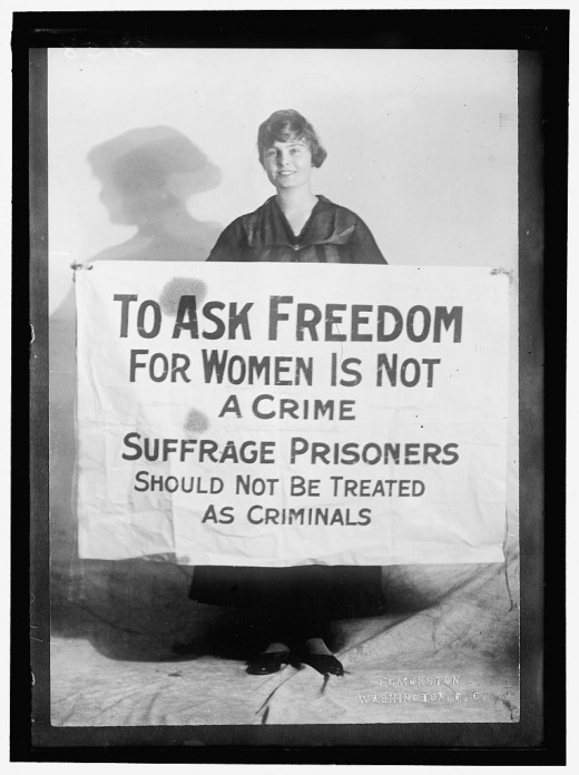 "Photograph labeled as ""Lucy Branham with Posters"""