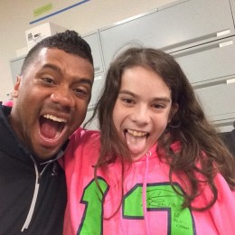 Great shot of Russell with young Brooke in the Seattle Childen's Hospital