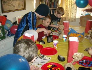 Here are the boys building their Lego cars