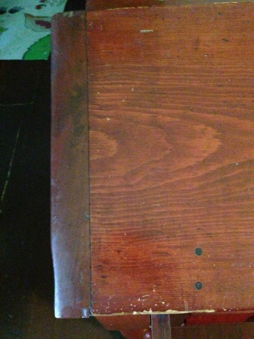 Edge of the slant top of the desk.