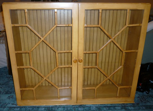 'Before' china cabinet hutch. Love the delicate fretwork doors & handmade beadboard back. The seller had the missing fretwork, which I re-installed.