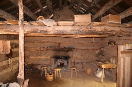 Inside a trappers log cabin at Conner Prairie living history museum in Fishers, Indiana. Photo by Derek Jensen en.wikipedia.org/wiki/File:Conner-prairie-log-cabin-interior.jpg