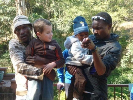 At Home - Stephen with his brother Tamai, Muzhingi Junior and Aiden Daniel Mark - a little happier than in the other picture :)