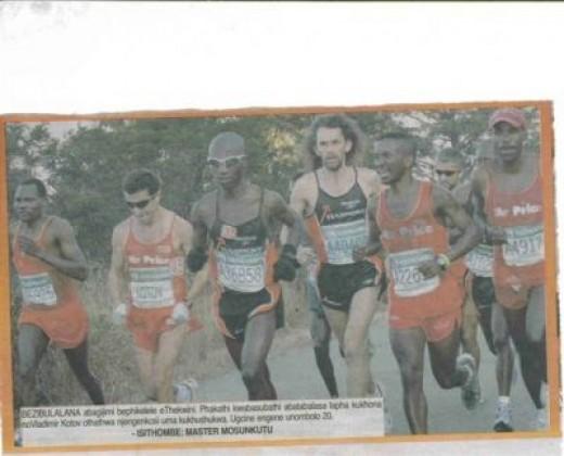 Newspaper Clipping Stephen Muzhingi running with his hero, Kotov, 2007