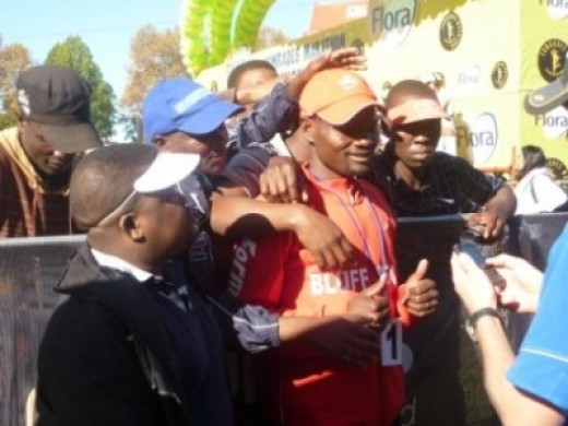 With fans after winning Comrades 2011
