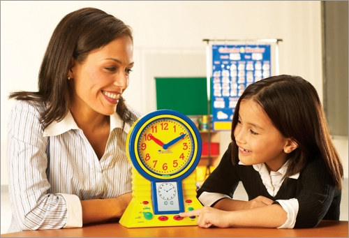 Mom Teaches Girl To Tell Time On Toy Clock