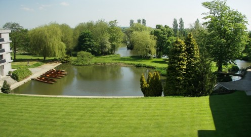 Photo of River Quad, punt harbour, island and the Cherwell River behind it, at Wolfson College Oxford.