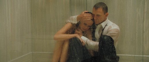 James comforting Vesper (Eva Green) in the shower after watching him take life