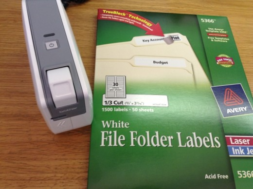 Using a label maker or printable labels will make your files look neater and will be easier to read.  I like label makers best.