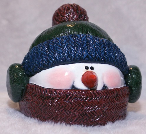 The hat comes off this cute snowman to make a wonderful Candy Dish.  He can be painted in any color scheme you like and will make a great gift!