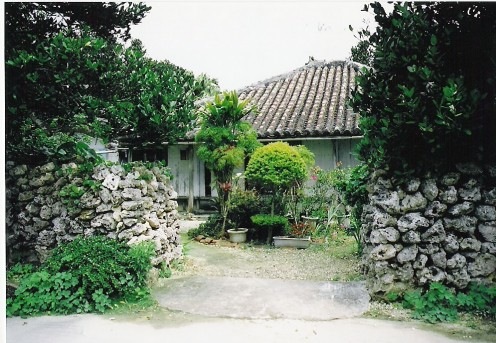 Traditional house on Hateruma-jimi with coral limestone typhoon walls.