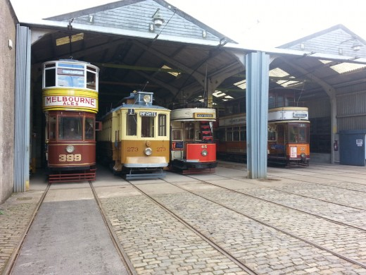 Trams in the depot at Crich Tramway Village.