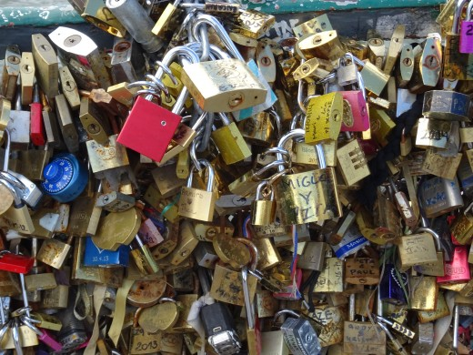 The huge Paris crowds leave layers of love locks on the bridges that threaten to pull them down
