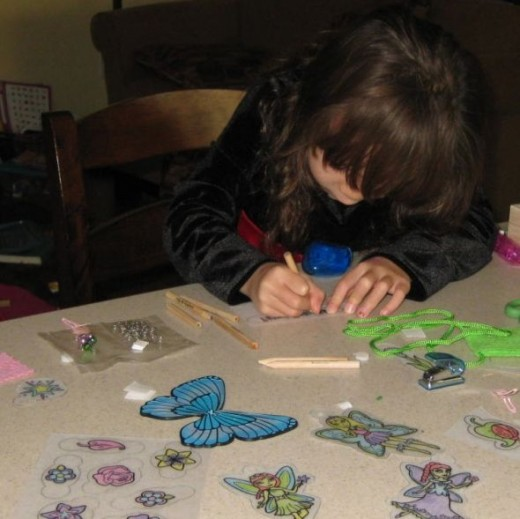 Girl coloring Shrinky Dinks from a kit.