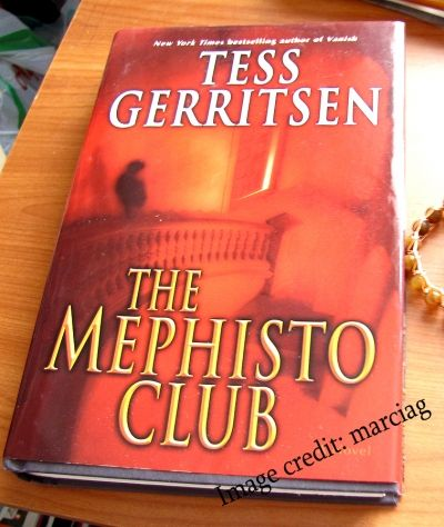 My harcover edition of Mephisto Club, it's already battered and tattered from use)