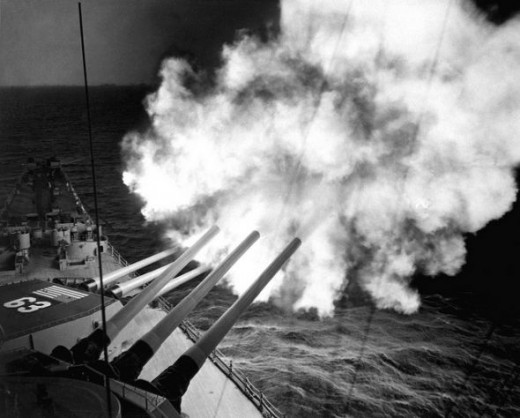 The USS Missouri fires 16-inch shell into enemy lines at Hungnam 1950