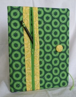 Here's a cool idea either find an existing book cover & include a pouch for pens or make your own!