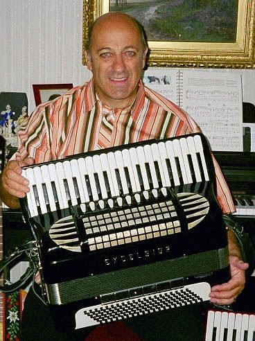 An Accordionplayer with hours of music in his hands