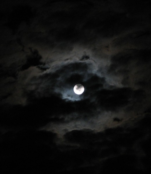 Clouds covering the moon make for a darker evening