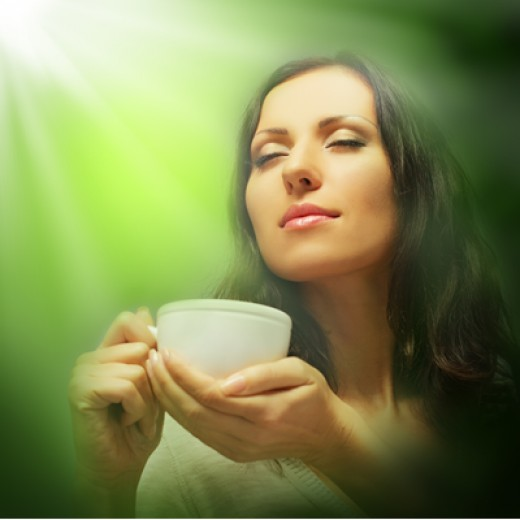 Woman relaxing with a hot drink