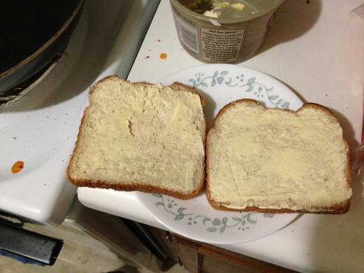 The outside of each piece of bread gets buttered.