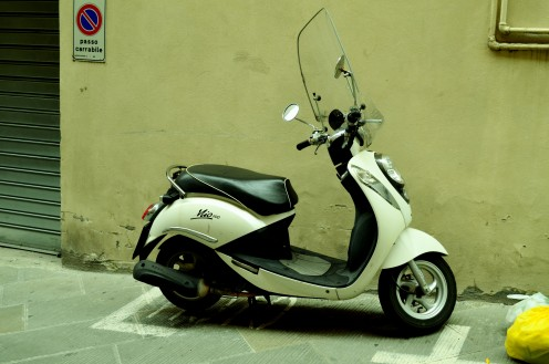 The Italian legend Vespa  got  parked in one of the lanes in Florence.