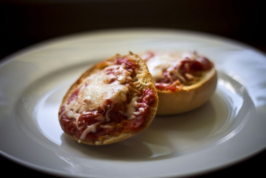 Pepperoni, mozzarella cheese, and tomato sauce toasted on a mini bagel.