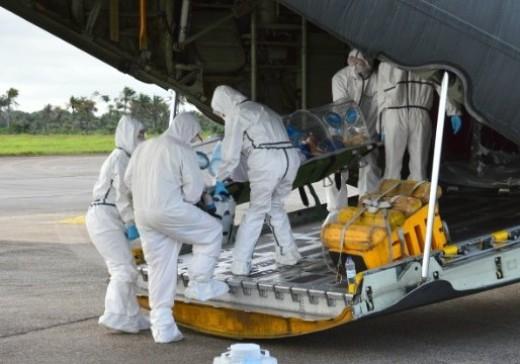 Medics Load a Victim into a Plane