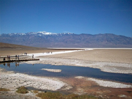Standing below sea level, looking at the Telescope Peak in the Panamint Range across the way which is 11,049 feet tall.