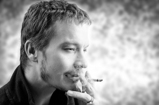 Young man smoking.  Younger people tend to smoke more than older people.  Men also tend to smoke more than women (although the gender gap is narrowing).