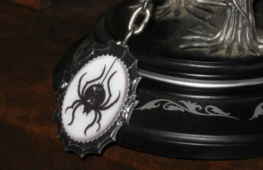 The spider cameo hanging on the bottom of this do it yourself barrette is also a sticker.