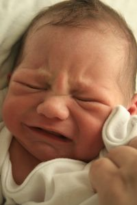 Babies cry for a certain reason. Since they can't communicate with us any other way, we have to try to find out why. It could be they are wet, hungry, have gas and need a back rub or burp, need to feel warm and comfortable, or are too warm.