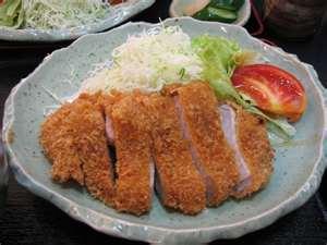 Japanese pork cutlets over shredded cabbage