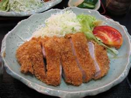Japanese pork cutlets over shredded cabbage