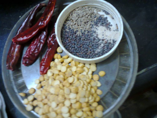 pulses, red chillies, other frying ingredients. coriander seeds missed in picture.
